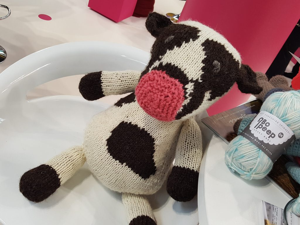 Prudence, the Cows on Tour prototype knitted cow